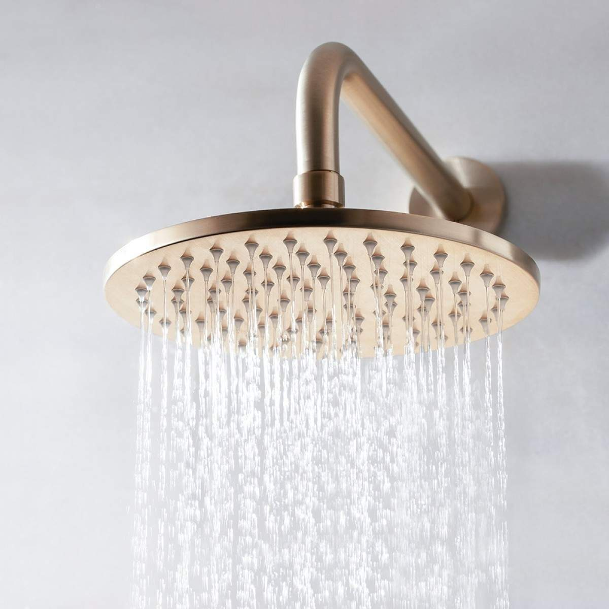 BathSelect Rio Round Stainless Steel Wall Mount Rainfall Shower Head In Brushed Gold Finish